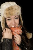 image of snuggle  - Asian Caucasian girl snuggling scarf and hat - JPG