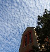 picture of stratus  - Old Building with blue sky and interesting patterns in the clouds - JPG