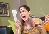 stock photo of smoker  - Angry smoker with drink yelling into telephone - JPG
