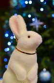 image of rabbit year  - new year rabbit toy decoration near new year tree - JPG