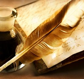 foto of inkpot  - Old book with feather and the inkpot full of ink - JPG