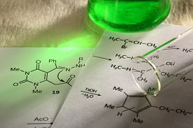 stock photo of chemical reaction  - Green chemistry with reaction formula in closeup - JPG