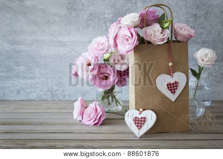 Romantic Retro style Love background with pink roses and handcrafted hearts