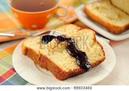 Mascarpone Cake Slice, Cup Of Tea In Orange Teacup, Blueberry Jam On White Bright Background Closeup