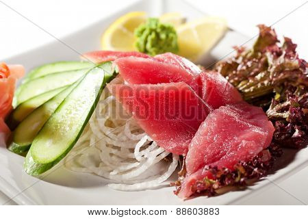 Tuna Sashimi - Sliced Raw Tuna on Daikon with Seaweed and Cucumber
