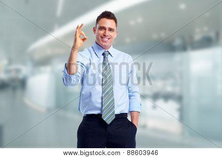 Young executive business man over blue background