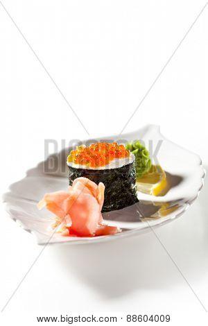 Ikura Gunkan Maki Sushi with Cream Cheese. Garnished with Ginger and Wasabi