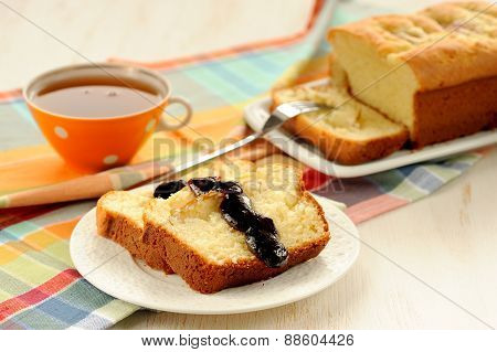 Mascarpone Cake Slice, Cup Of Tea In Orange Teacup, Blueberry Jam On White Bright Background
