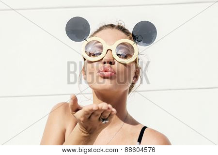 Cute Blonde Wearing Sunglasses And Sending A Kiss