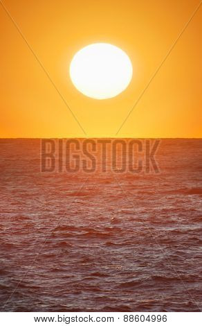 Big sun on the sea. Nature composition.
