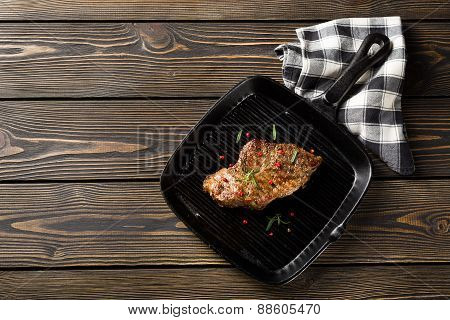 Beef Steak On Grill Pan On A Wooden Table Top View