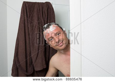 Man With Shampoo In His Hair In Hi S Bathroom
