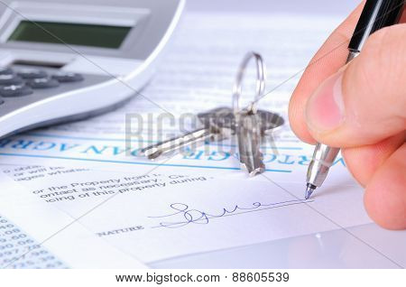 Signing The Mortgage Contract To Delivery Of Keys With Calculator