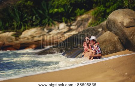 The happy couple spends holidays on a tropical beach.