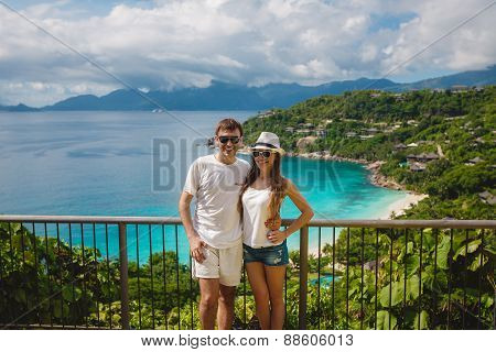 Couple relaxing on a tropical resort in the Seychelles, La Digue.