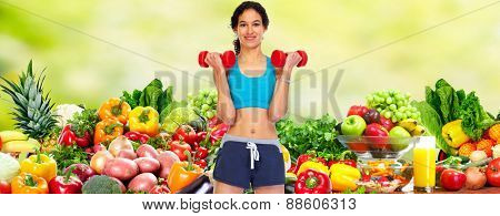 Happy young woman over healthy diet background.