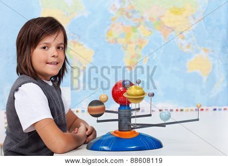 Young boy in school learning about the solar system