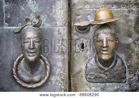 Door With Head Of Woman And Man
