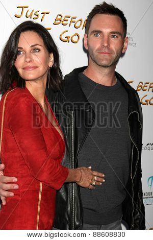 LOS ANGELES - FEB 20:  Courteney Cox, Johnny McDaid at the