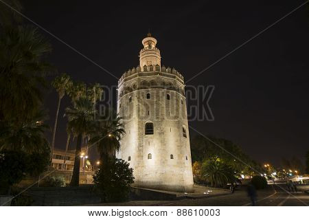 Night View Of The Gold Tower In Seville, Spain.