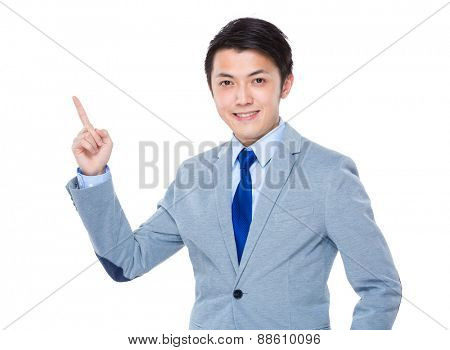 Asian business man smiling and finger pointing up