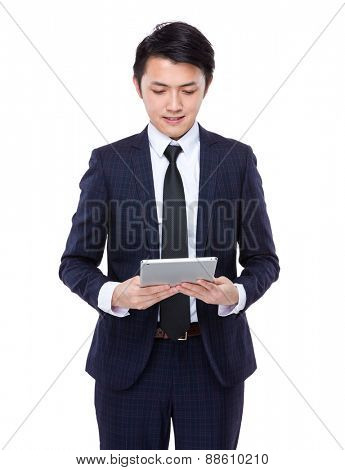 Businessman use of the digital tablet
