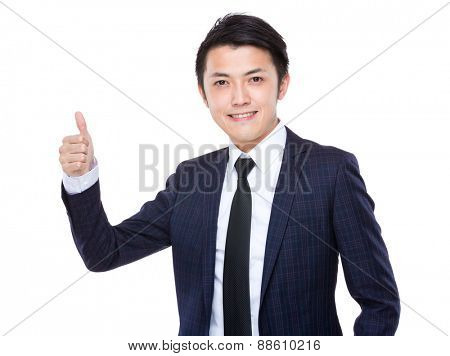 Businessman with thumb up gesture