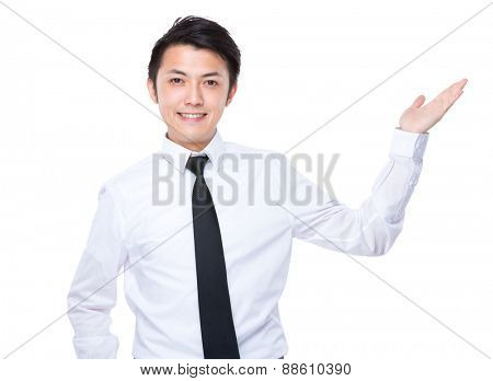 Businessman with hand show with something