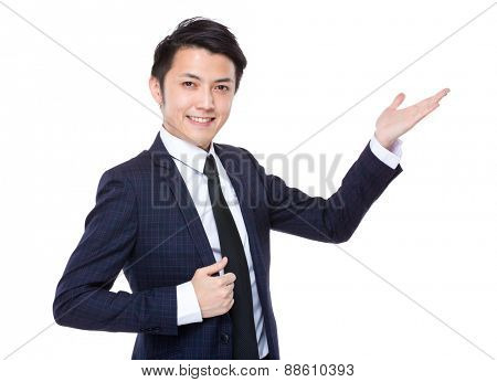 Businessman with open hand palm for showing something