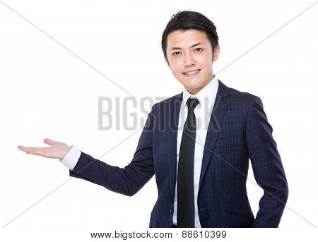 Businessman with hand showing something