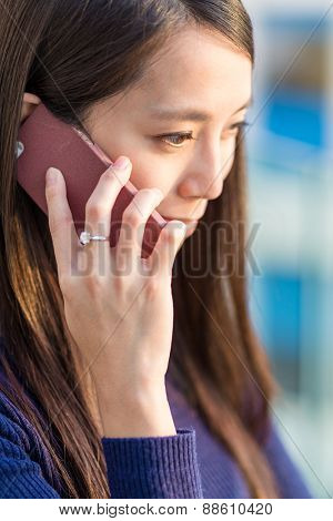 Beautiful smiling young woman talking on cell phone