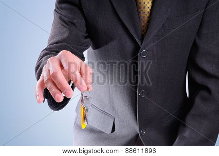 Half-body Commercial Agent With Keys In Hand Isolated
