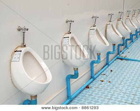 A row of men toilet