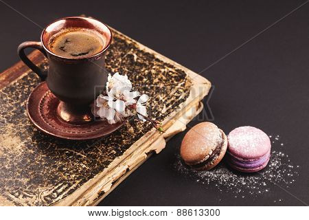 Vintage coffee with flower and macaroons