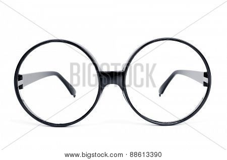 closeup of a pair of round-lens eyeglasses on a white background