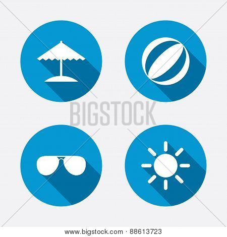 Beach holidays icons. Umbrella and Sunglasses.