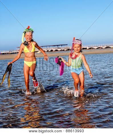 Children playing on  beach. Snorkeling. Raunning on water.