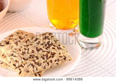 Sweet Cake On White Plate With Fresh Juice