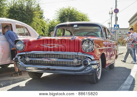 Old red Chevrolet on exhibition of vintage cars