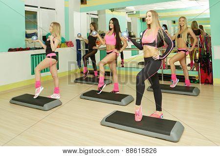 Fitness center. Image of athletic girls training
