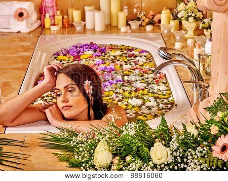 Woman relaxing at water flower spa.