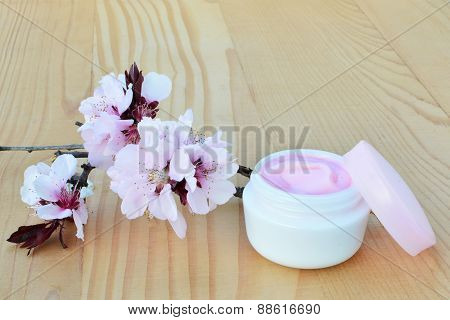 Cosmetic Cream With Cherry Blossoms.