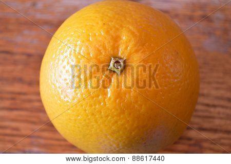 Orange On Wood Table, Closeup