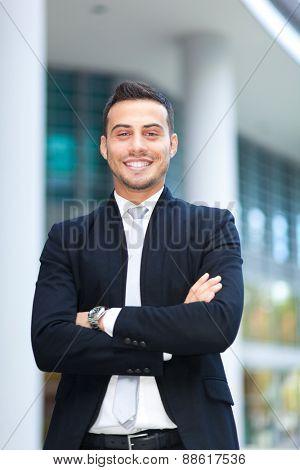 Smiling business man portrait outdoor