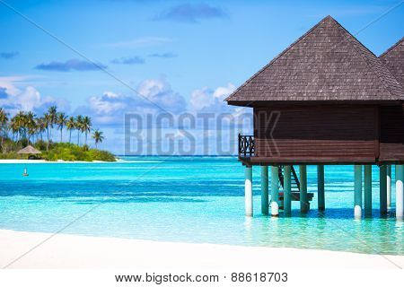 Water bungalows with turquiose water on Maldives
