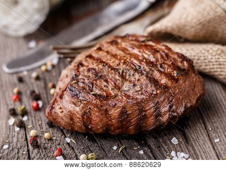 Beef steak on a wooden board
