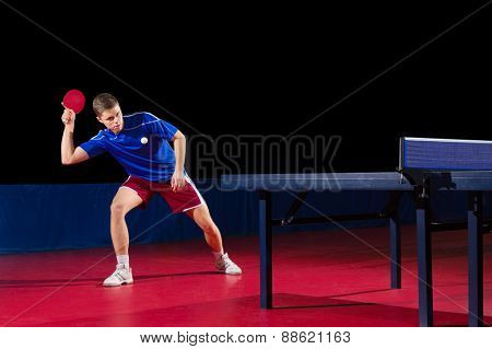 Table tennis player isolated on black