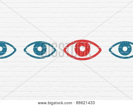 Privacy concept: eye icon on wall background