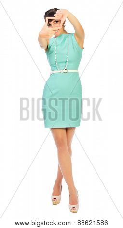 Glamorous girl in turquoise dress shows frame gesture isolated