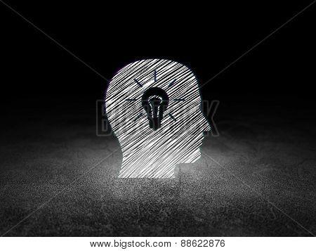 Finance concept: Head With Light Bulb in grunge dark room